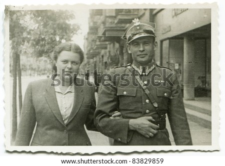 Vintage photo of young soldier and his wife (forties) - stock photo