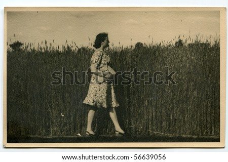 Vintage photo of young woman - stock photo