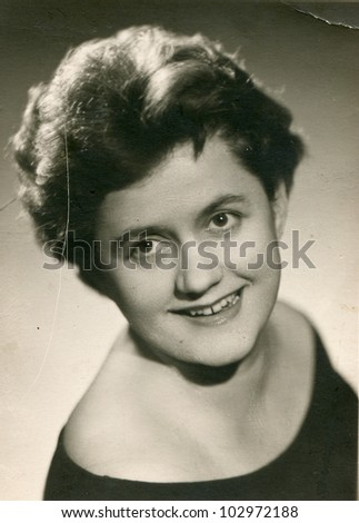 Vintage photo of young woman (sixties) - stock photo