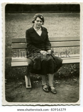 Vintage photo of young woman (thirties) - stock photo
