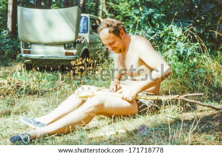Vintage photo (scanned reversal film) of man carving (early eighties) - stock photo