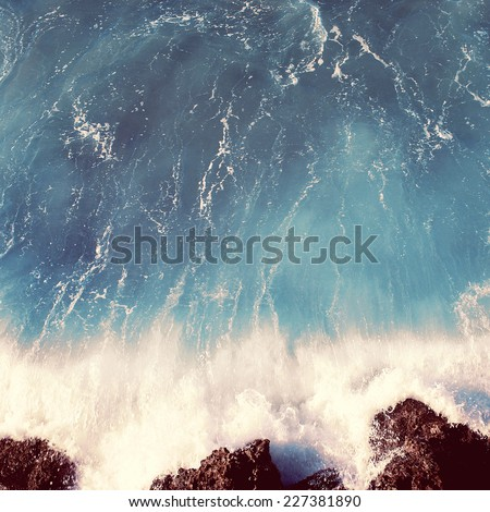 Vintage photo sea landscape, wave and rocks, soft pastel colors - stock photo