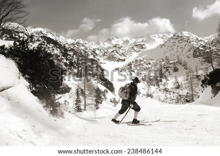 Vintage photos old skier with traditional old wooden skis  - stock photo