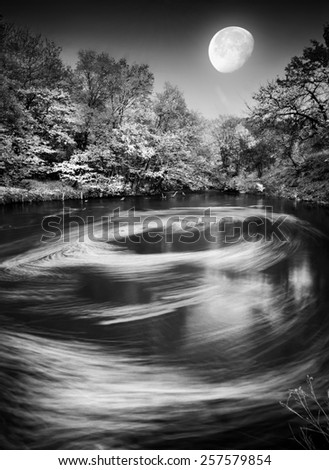 Vintage picture. Moonrise over the Autumn river with whirlpool. Monochrome colors - stock photo