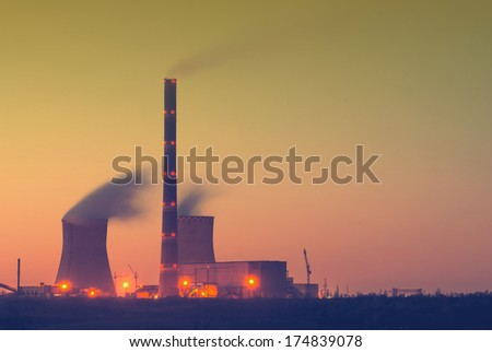Vintage picture. Morning over the coal power plant with smoke at long exposure - stock photo