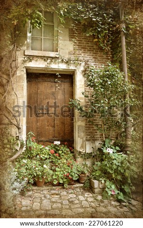 Vintage picture of beautiful porch decorated with flowers in Paris - stock photo