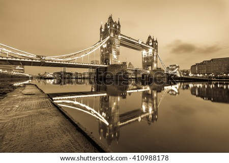 Vintage Picture of Tower Bridge with beautiful water reflection during low tide in London, England - stock photo