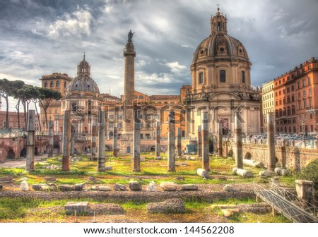 Vintage picture of Trajan's column and view on the cathedral on Piazza Venezia in Rome, Italy with grunge effect - stock photo