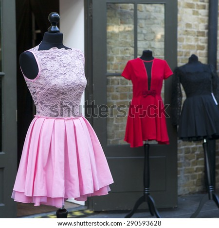 vintage pink dress from charity shop - stock photo