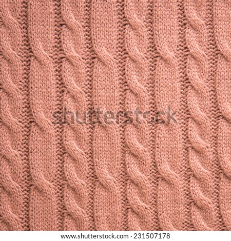 Vintage pink knitting wool texture background - stock photo