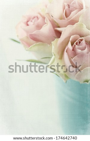 Vintage pink roses on textured light blue background - stock photo
