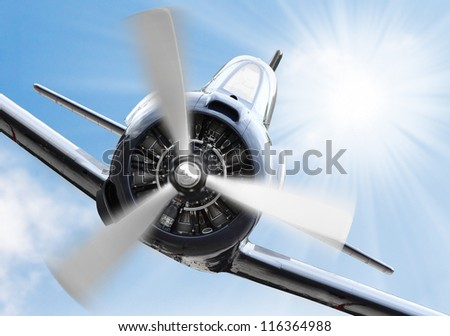 Vintage plane on a sunny sky. Retro technology background. - stock photo