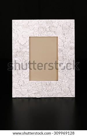 Vintage plaster frame on black background - stock photo