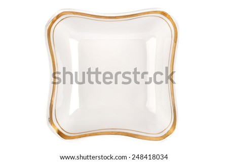 Vintage plate of unusual shape with gold rim isolated. Bowl top view. - stock photo
