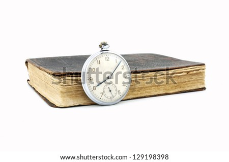 Vintage pocket watch and old book - stock photo