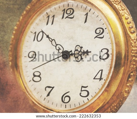 vintage pocket watch in gold frame. With the effect of crumpled paper and retro toning