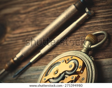 vintage pocket watch on a table watchmaker. instagram image retro style - stock photo