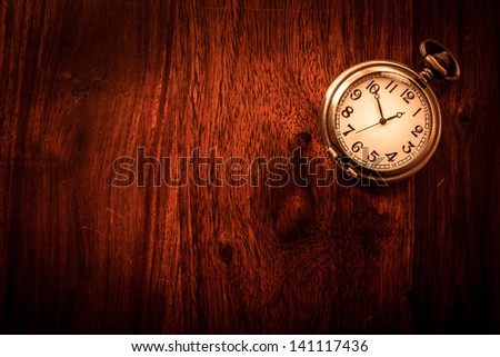 stock-photo-vintage-pocket-watch-on-soli...117436.jpg