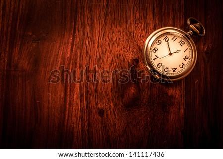 stock-photo-vintage-pocket-watch-on-soli...117436.jpg