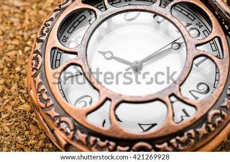 Vintage pocket watch on wood table. - stock photo