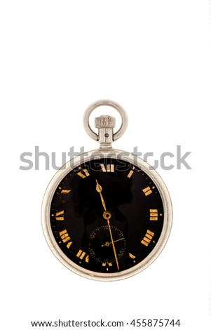 Vintage pocket watch with a black dial isolated on white background. - stock photo