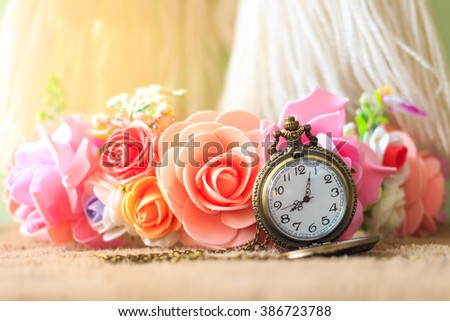 Vintage pocket watch with rose bouquet - stock photo