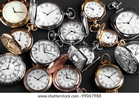vintage pocket watches on black background - stock photo