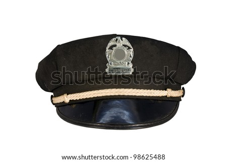 vintage police motorcycle cap with badge isolated over a white background - stock photo
