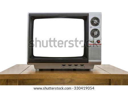 Vintage portable television and old wood table isolated on white with cut out screen. - stock photo