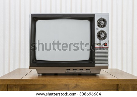Vintage portable television set on a old craftsman style table.   - stock photo