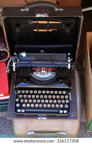 Vintage Portable Typewriter With German Layout in Case - stock photo