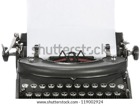 Vintage portable typewriter with paper on white. - stock photo