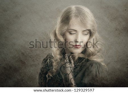 vintage portrait beautiful blond woman with eyes closed on old paper