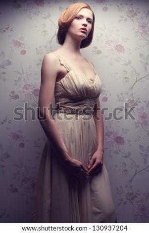 Vintage portrait of a glamorous doll-like retro girl posing in gorgeous classic dress . Hollywood style (film noir). Studio shot - stock photo
