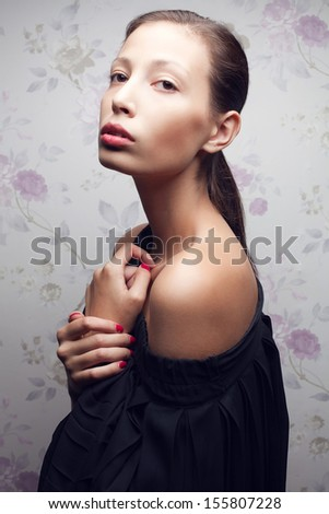 Vintage portrait of a glamorous retro girl posing in gorgeous classic dress . Hollywood style (film noir). Perfect skin and hairdo. Close up. Studio shot  - stock photo