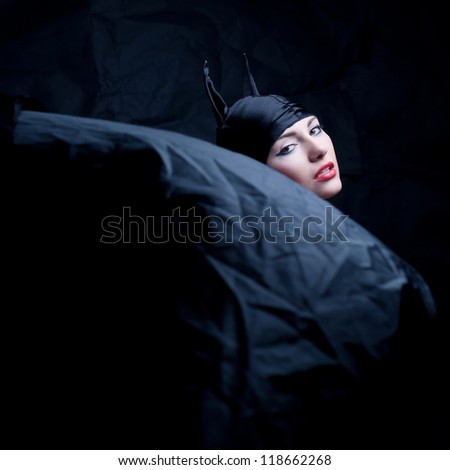 vintage portrait of a glamourous animal girl over wrinkled black paper background. studio shot - stock photo