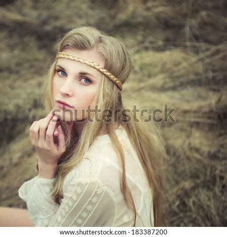 Vintage portrait of a sexy blonde in nature