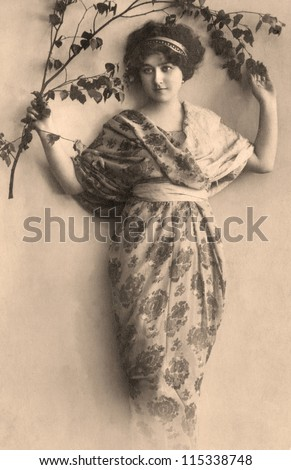 Vintage portrait of a young girl. The shot was taken around 1915 year. - stock photo