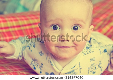 Vintage portrait of adorable surprised baby boy