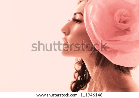 Vintage portrait of fashion glamour girl with red flower in her hair. Studio shot. - stock photo