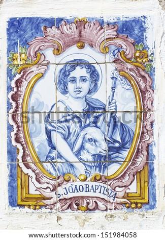 vintage portuguese tiles with saint john - stock photo