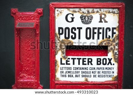 Vintage postbox weathered by age in English town