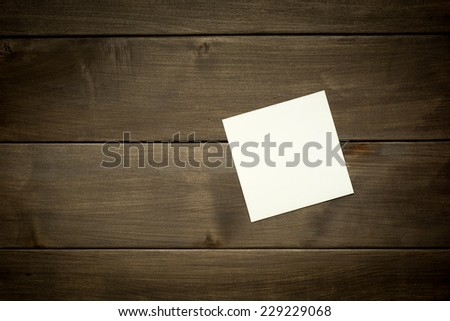 Vintage postcard on wooden table with copy space - stock photo