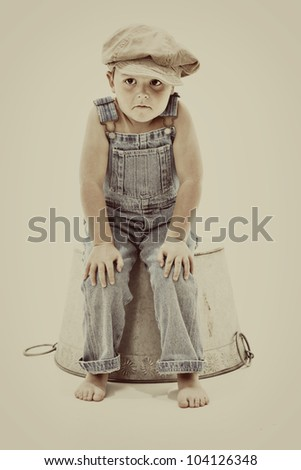 Vintage pout: adorable young boy with a grumpy expression - stock photo