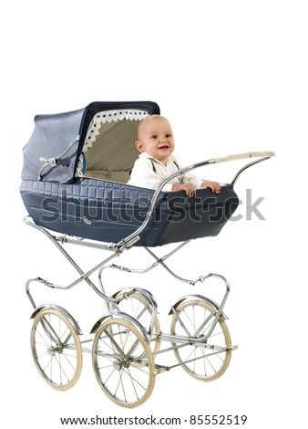 vintage pram English, with smiling child sitting on - stock photo