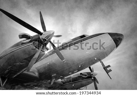 VIntage propeller airplane nose and engines in sepia tones