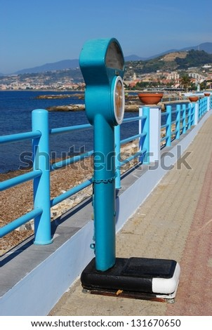 Vintage public weight scale in front of the sea, Santo Stefano al Mare, Liguria, Italy - stock photo