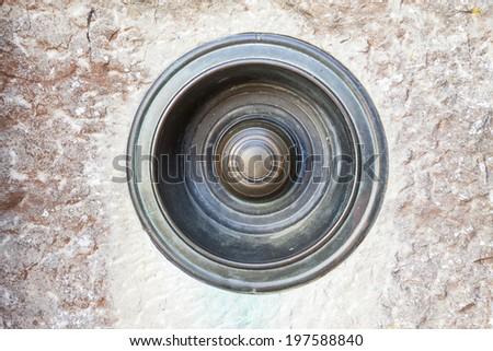 Vintage pull door/house bell on textured brickwork background. - stock photo