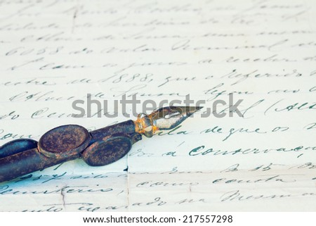 vintage  quill pen and antique letter, retro toned - stock photo