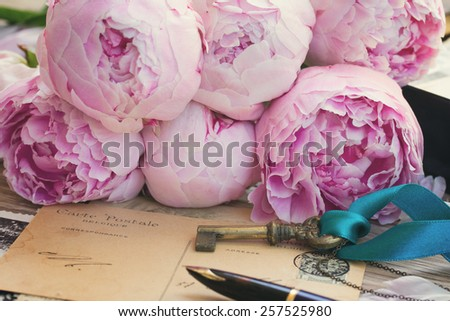 vintage quill pen and antique letters with peonies flowers and key, retro toned - stock photo